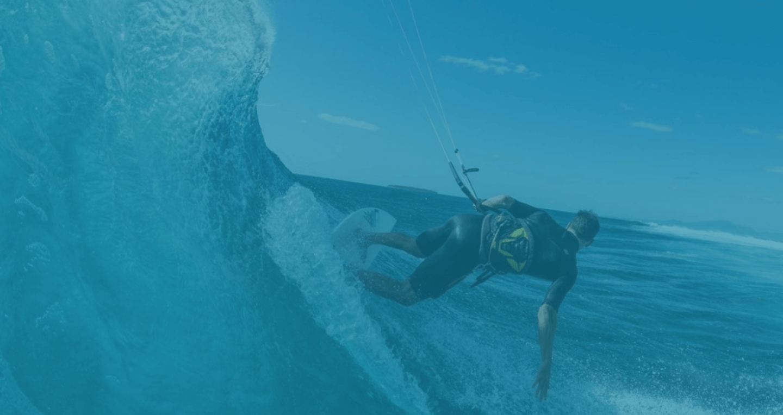 Person kitesurfing in ocean