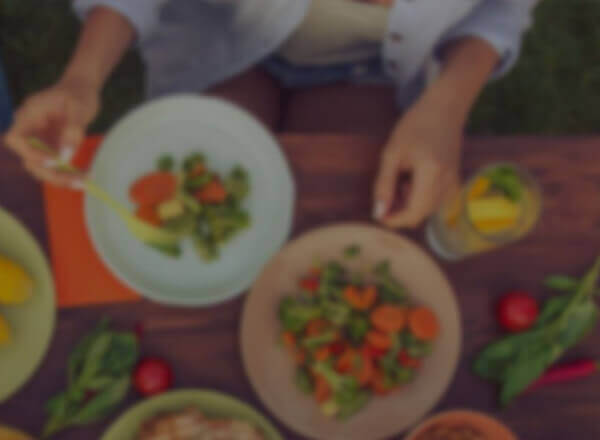 Person serving salad