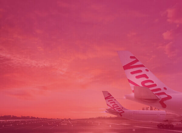 Virgin airplanes on airport tarmac