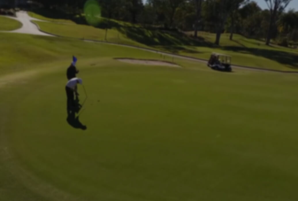 People putting on golf green