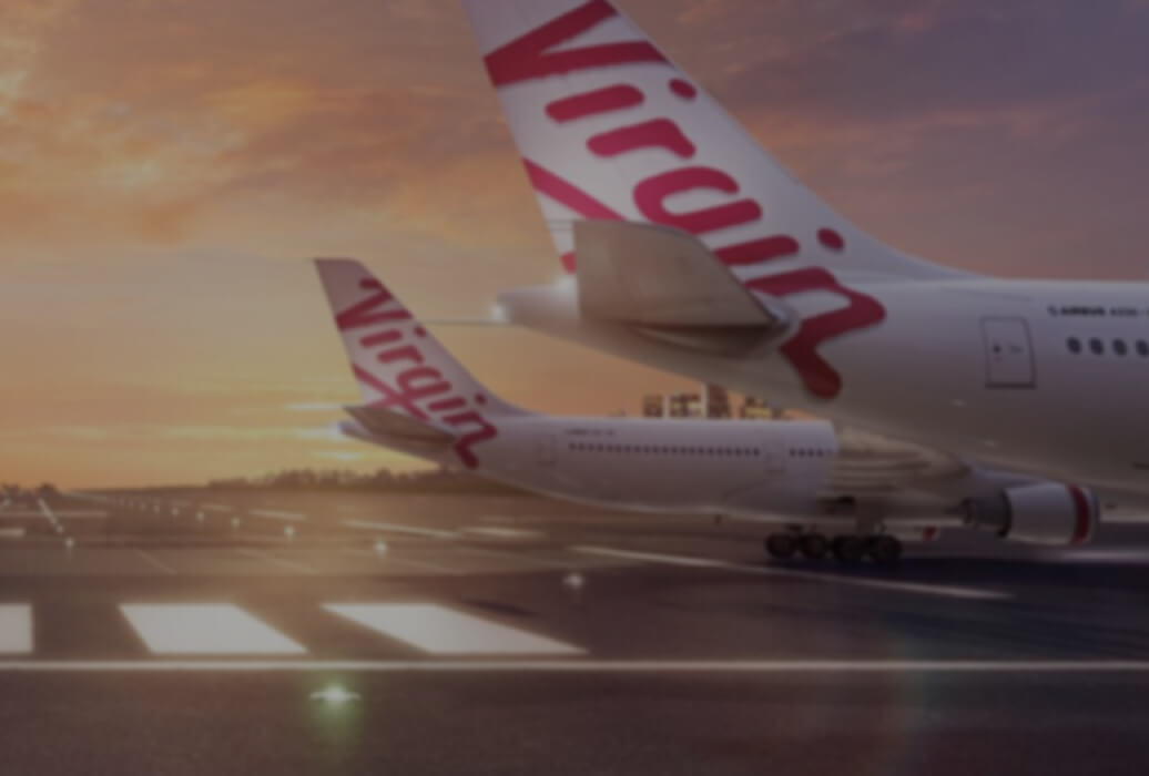 Virgin airplanes on airport tarmac